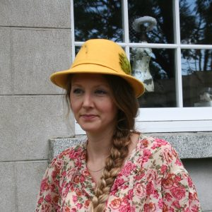 Yellow felt trilby wool fel hat with olive green feather