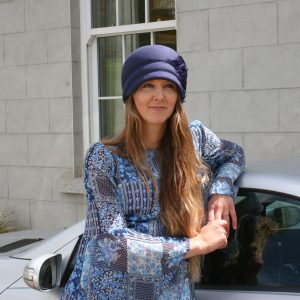Peach Bloom navy felt hat with navy feather pad