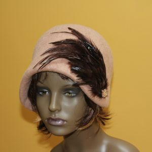 Front view of beige cloche felt hat with brown feather