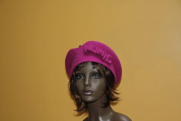 Fushia felt hat witha matching felt design to the side
