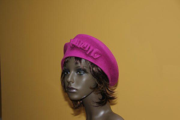 Fushia beret with felt adornment