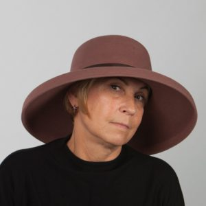 Front view of a wide brimmed chocolate wool felt hat with brown ribbon detail around crown