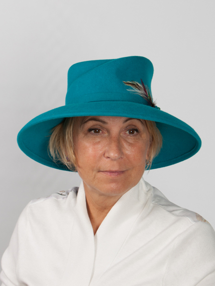 Front view large brimmed turquoise felt hat with felt band and feather detail