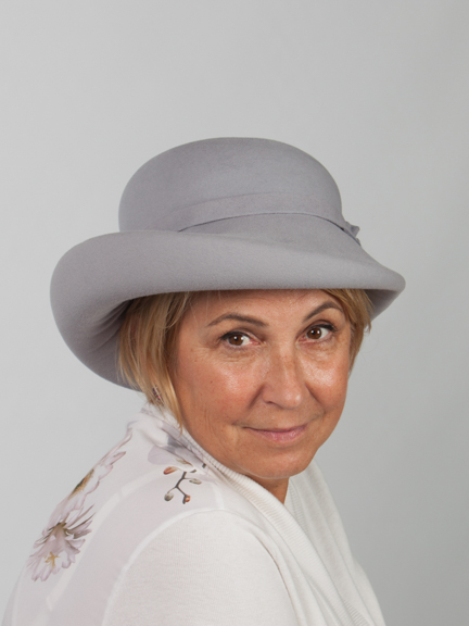 Front view head shot silver felt hat with matcing flt band around crown.