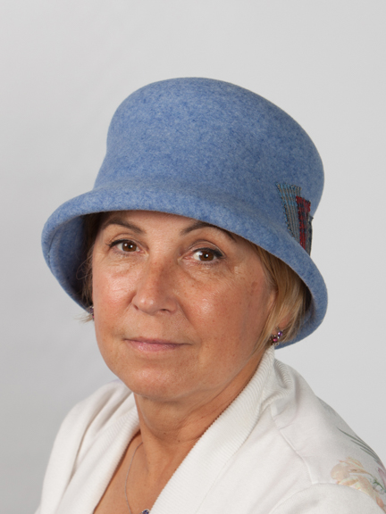 Front view of a light blue wool felt hat with a patchwork design added to the side