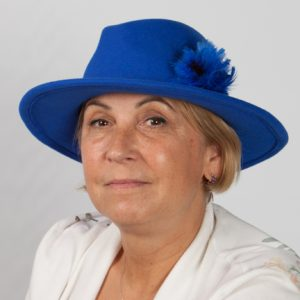 Front view headshot of royal blue large brimmed hat with matching felt band around crown and royal blue feather detail.feather e