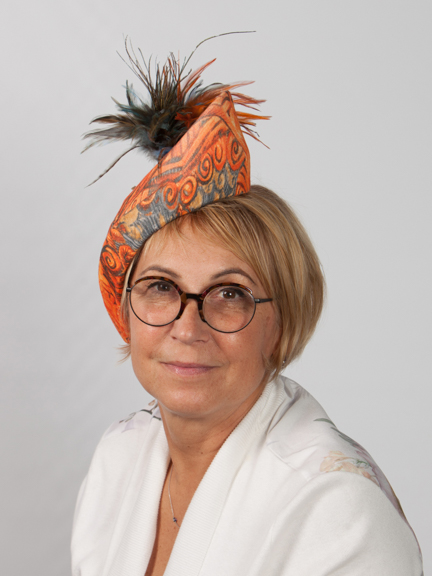 Front view of orange with a touch of blue hat and feather detail