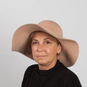 Beige large brimmed felt hat with felt band.